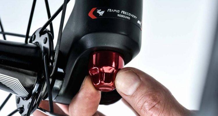 Descubre para qué sirve la rosca roja que tiene la suspensión en la parte inferior